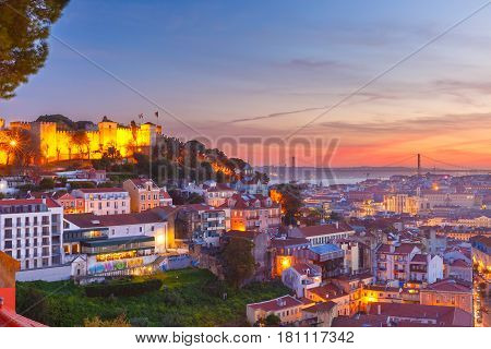 The Castle of Sao Jorge, the historical centre of Lisbon, Tagus River and 25 de Abril Bridge at scenic sunset, Lisbon, Portugal