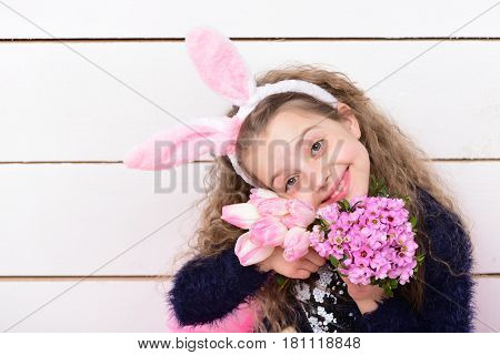 Happy Girl In Easter Bunny Ears With Pink Tulip Flower