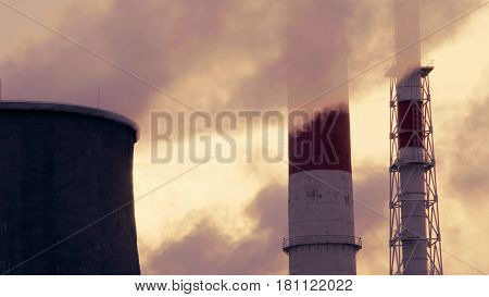 Smoking pipes of power plant on sky background Moscow march.