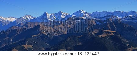 Famous mountains Eiger Monch and Jungfrau. View from mount Niesen. Autumn day in the Bernese Oberland.