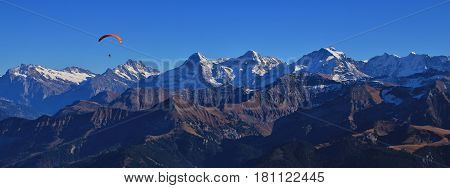 Famous mountains Eiger Monch and Jungfrau seen from mount Niesen.