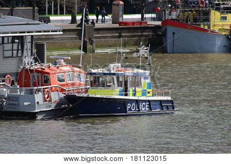 London, March 2017. The Nina Mackay II, a boat used the Metropolitan Police's Marine Policing Unit, seen moored on the River Thames alongside Fire and Rescue boats operated by the London Fire Brigade
