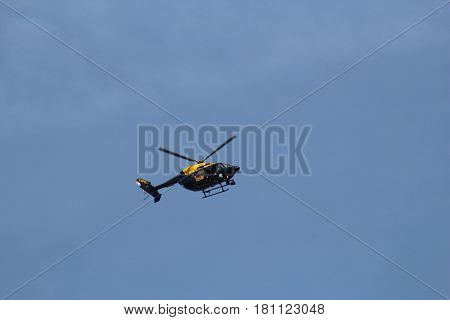 London, March 2017. A helicopter carrying the markings of London's Metropolitan Police and operated by the United Kingdom's National Police Air Service, flies above Westminster