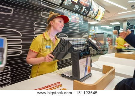 SAINT PETERSBURG, RUSSIA - CIRCA NOVEMBER, 2016: worker at McDonald's restaurant. McDonald's is an American hamburger and fast food restaurant chain.