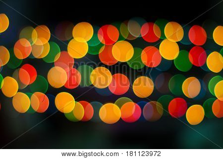 Brilliant circle bokeh made by blurry colorful lights