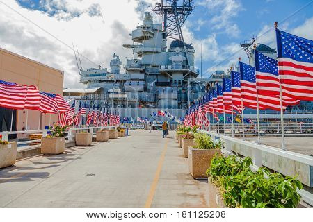 HONOLULU, OAHU, HAWAII, USA - AUGUST 21, 2016: Battleship Missouri Memorial with American flags at Pearl Harbor in Honolulu Hawaii, Oahu island of United States. National historic patriotic landmark.