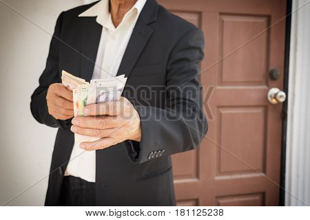 old businessman buy the house with singapore money banknote - can use to display or montage on product