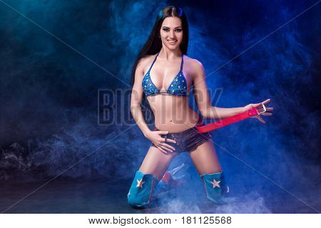 sexy young woman in erotic fetish wear dancing striptease in nightclub. Beautiful nude body of sensuality elegant lady. Nude sexy woman in Show suit. Sexy female fetish-wear. Erotic portrait