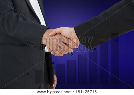scene of commitment deal with businessman shaking hand and bar graph up background - can use to display or montage on product