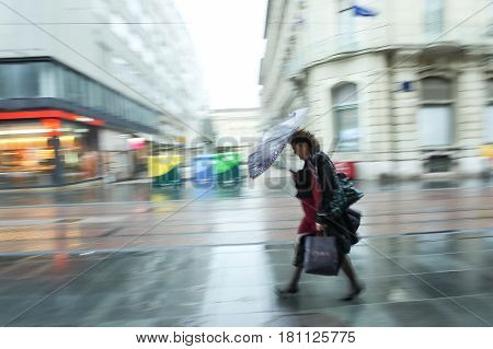 Motion Of Woman In A Rain