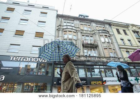 People With Umbrellas On Rainy Day