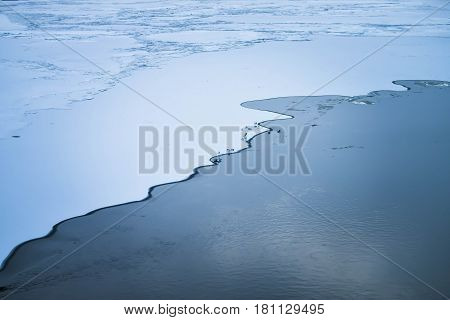 Icy coastline the boundary between water and ice the birds on the ice