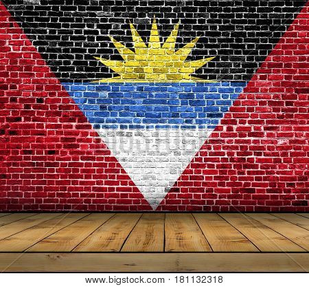 Antigua Barbuda flag painted on brick wall with wooden floor
