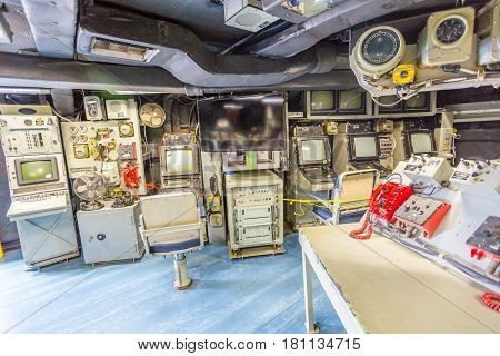 HONOLULU, OAHU, HAWAII, USA - AUGUST 21, 2016: Panorama of war room with battle stations and instruments, consoles of Battleship Missouri at Pearl Harbor. Popular tourist attraction in Honolulu.