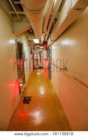 HONOLULU, OAHU, HAWAII, USA - AUGUST 21, 2016: Missouri battleship hallway and doors with red alert light in Pearl Harbor base.