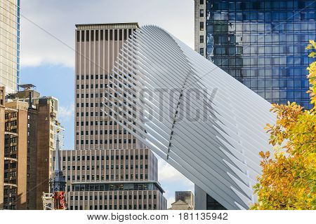 New York USA november 2016: Distinctive architectural form of the Oculus transportation hub stands in front of a bright view of the One World Trade Center tower.