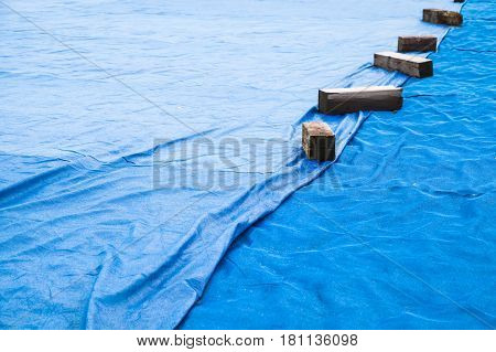 Blue Industrial Mesh Textile With Wooben Planks