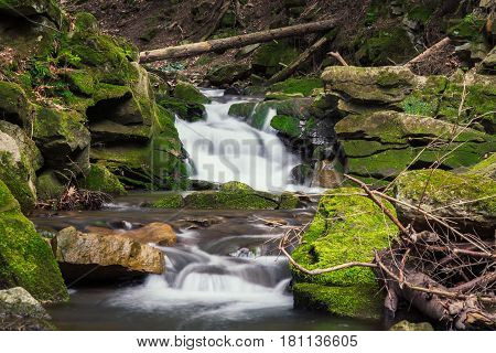 Forest brook between mossy rocks. outdoor. wallpaper