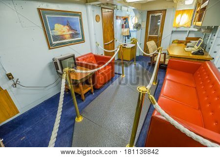 HONOLULU, OAHU, HAWAII, USA - AUGUST 21, 2016: exclusive commander cabin with sofa and living room with desk of Battleship Missouri at Pearl Harbor. The end World War II was signed on this warship