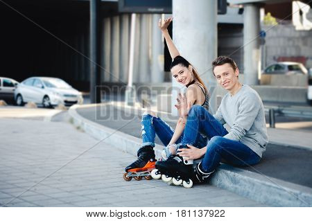 Holidays, active people and friendship concept. rollerblade