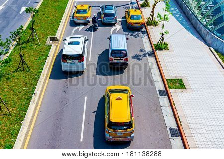 TAIPEI TAIWAN - MARCH 28: This is an aerial view of road with taxis waiting at traffic lights in Xinyi financial district on March 28 2017 in Taipei
