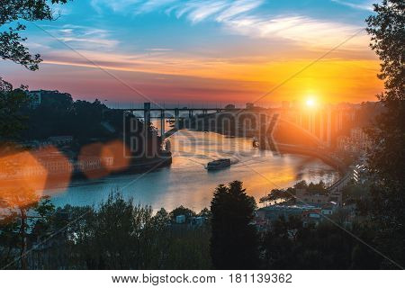 View of the Douro river at sunset, Porto, Portugal.