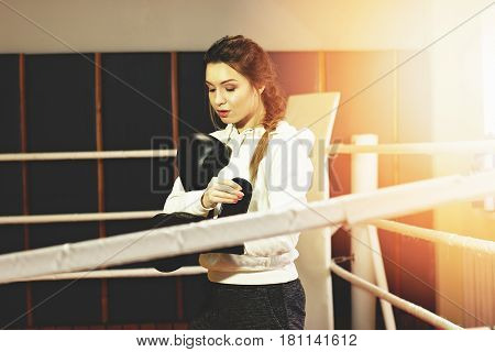 Portrait Of Beautiful Boxing Girl Wearing Black Boxing Gloves In The Ring. Training At The Gym. Spor