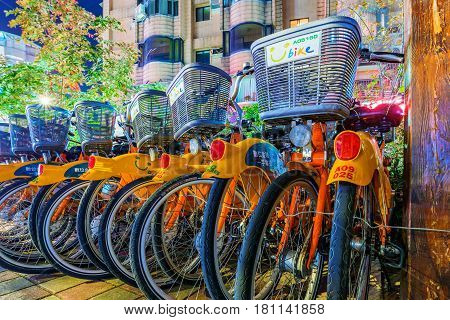 TAIPEI TAIWAN - MARCH 05: This is a U bike rack at night in Taipei. U bikes are public bikes which can be used for a small fee to travel around Taipei on March 05 2017 in Taipei