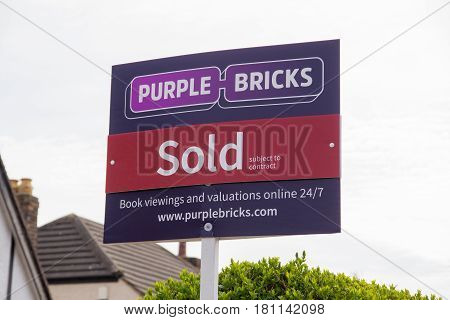 Wrexham UK - April 11 2017: Purple Bricks Group PLC estate agents sold sign the company is the UKs first online property agent launched in 2014 it challenges traditional sellers with their low fees
