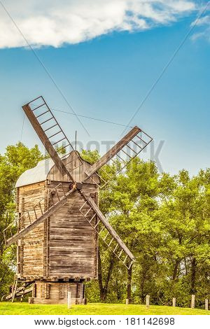 Old Russian wooden windmill. Summer rural scene.