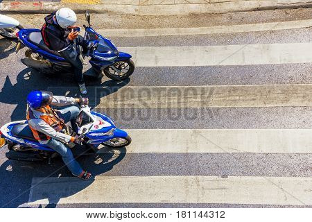 BANGKOK THAILAND - FEBRUARY 07: Thai people waiting at a crossing on motorbikes for the light to change in the downtown area of Bangkok on February 07 2017 in Bangkok
