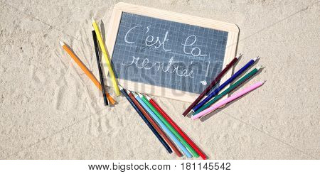 Pencils A Slate Schoolboy Posing In The Sand With Writing Back To School In French C Est La Rentree