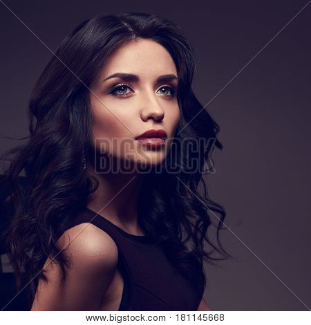 Beautiful Makeup Model With Effect Brow And Curly Hairstyle Posing On Dark Shadow Background And Loo