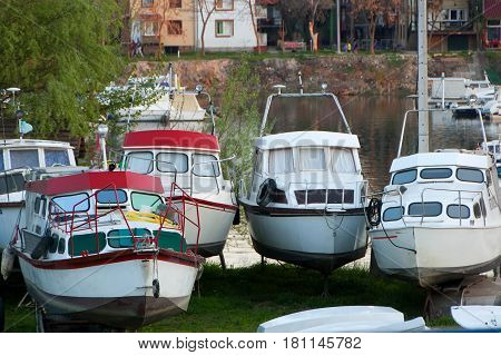 Boats and floating houses in the harbor. House was built on a steel platform structure with steel pontoons