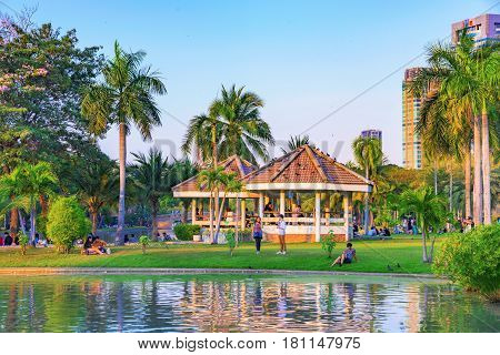 BANGKOK THAILAND - FEBRUARY 04: This is a view of Chatuchak park lakeside area where many locals and tourists come to sit and relax on February 04 2017 in Bangkok