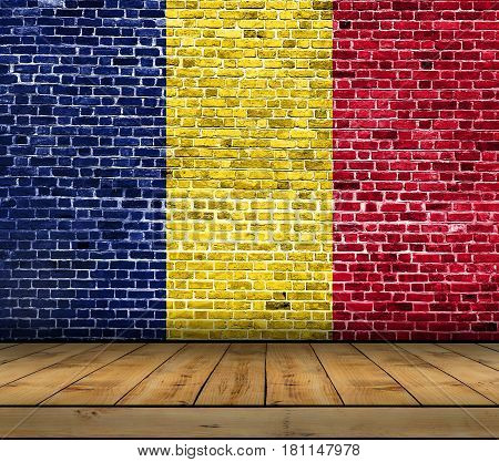 Chad flag painted on brick wall with wooden floor