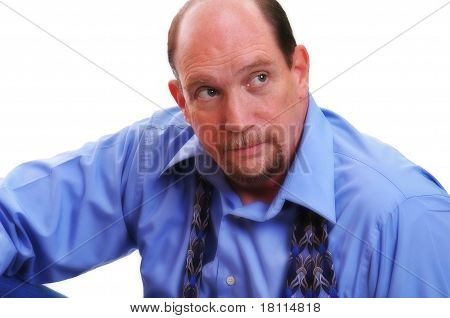Man sitting, looking off to side