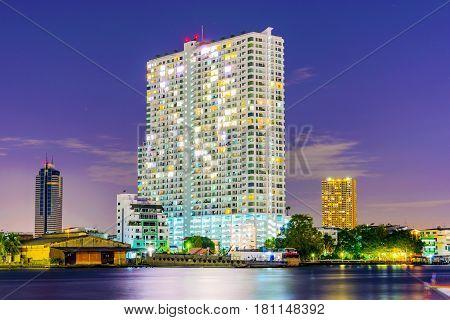 BANGKOK THAILAND - FEBRUARY 04: High rise apartment building overlooking the Chao Phraya river on February 04 2017 in Bangkok