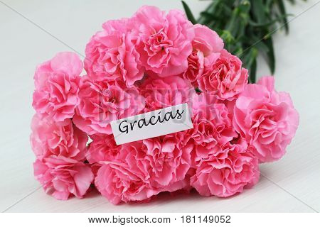 Gracias (which means thank you in Spanish) card with pink carnations