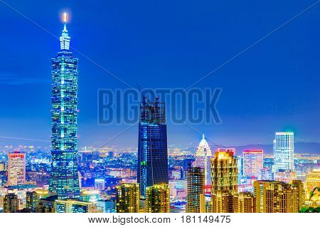 TAIPEI TAIWAN - NOVEMBER 18: This is a night view of Taipei 101 and Xinyi financial district architecture taken from Elephant mountain on November 18 2016 in Taipei