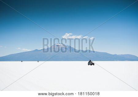 Salt flat Salar de Uyuni and volcano Tunupa in the background Altiplano Bolivia