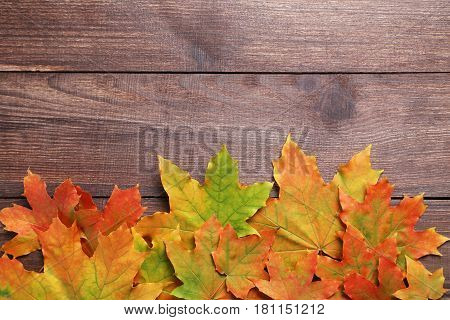 Autumn leafs on the brown wooden table