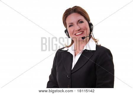 Cute business woman wearing headset