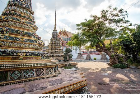 Panorama of Ancient Stupas and pagoda in Wat Pho - famous landmark in Bangkok. Wat Pho is a Buddhist temple complex in Bangkok, traditional outdoor landscape of Thailand.