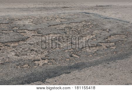 Closeup To Bad Condition Of Asphalt Road