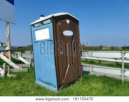 Transportable Modern Designed Portable Public Street Toilet Is Placed At Building Site, Outdoor Priv