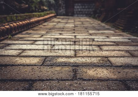 Ancient pavement leading into the distance with vanishing point as ancient background in vintage style