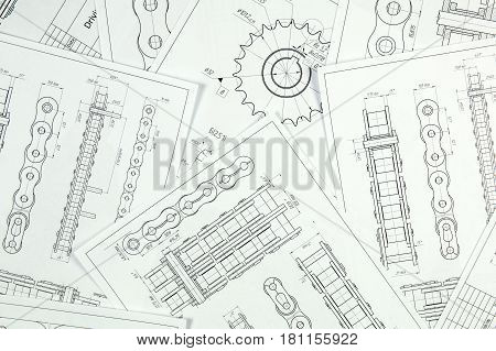 Technical engineering drawing details of drive industrial chain sprocket and mechanisms. Mechanical engineering technology of metal processing.Engineer working.