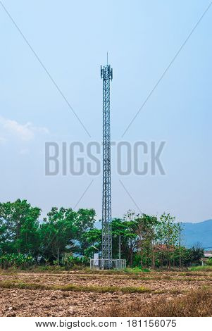 Metal Cellular Antenna Tower in Countryside Scene