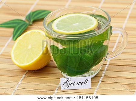 Get well card with fresh lemon on rustic wooden surface
